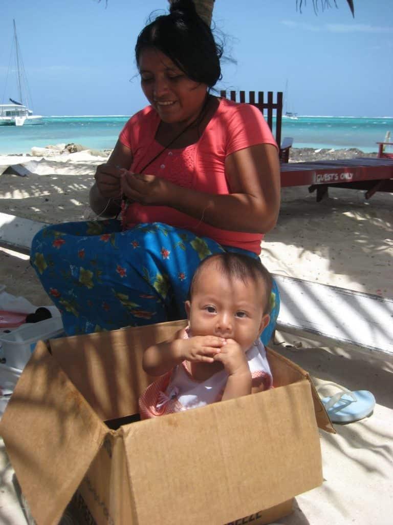 Beautiful Mayan baby in a box on Ambergris Caye